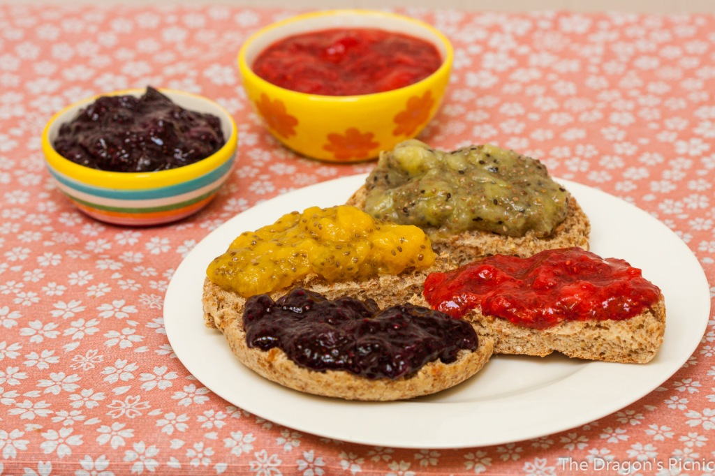 plate of toast with kiwi, peach, strawberry and blueberry chia jam