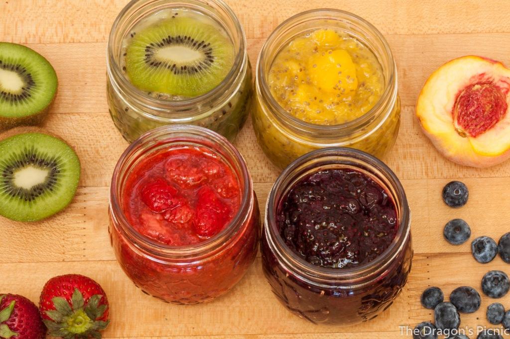 row of jars of kiwi, peach, strawberry, blueberry chia jam