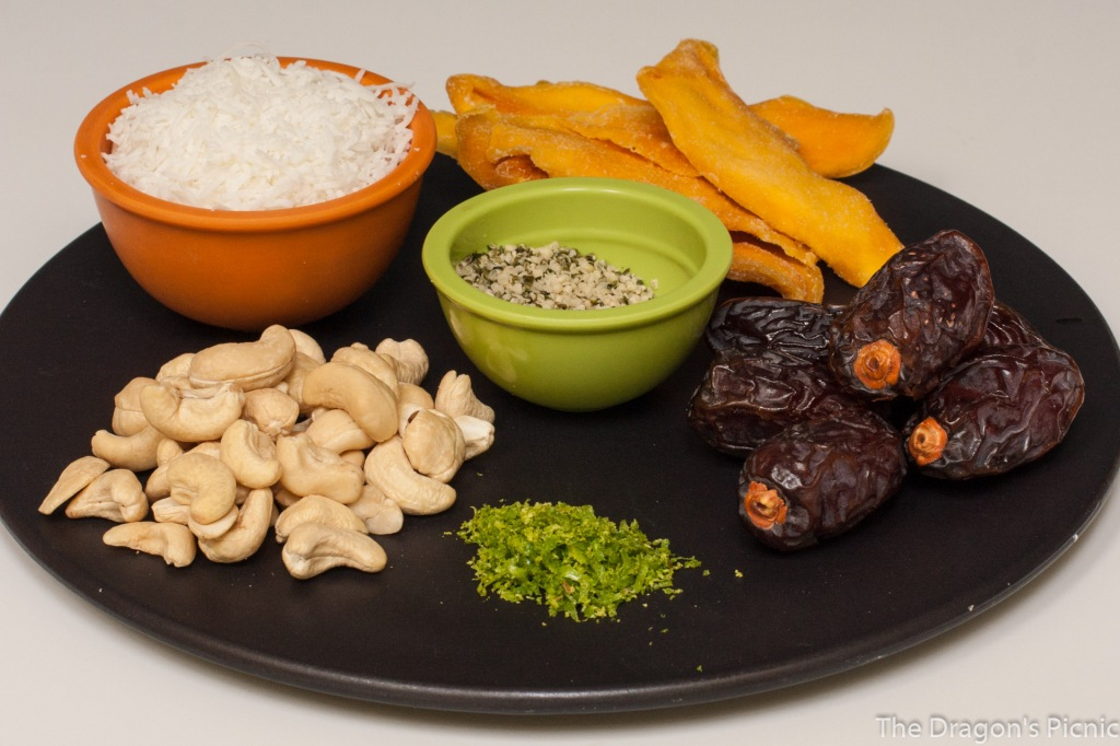 ingredients for mango and date energy bites - shredded coconut, dried mango, hemp seeds, cashews, medjool dates, lime zest