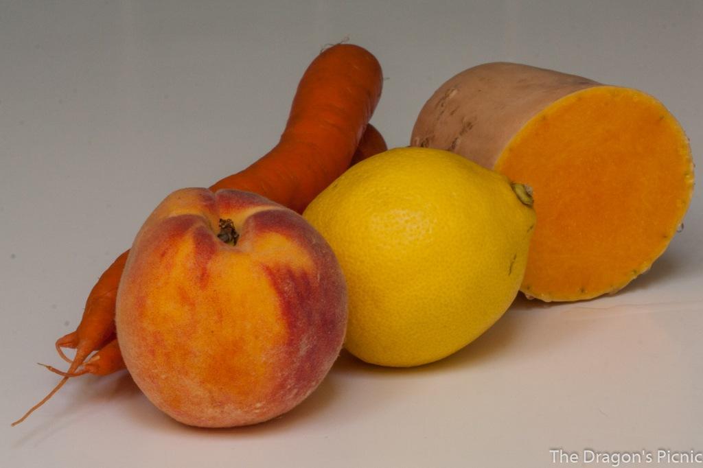 yellow and orange foods - carrots, peach, lemon, butternut squash