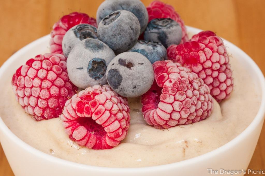 bowl of nice cream with frozen berries