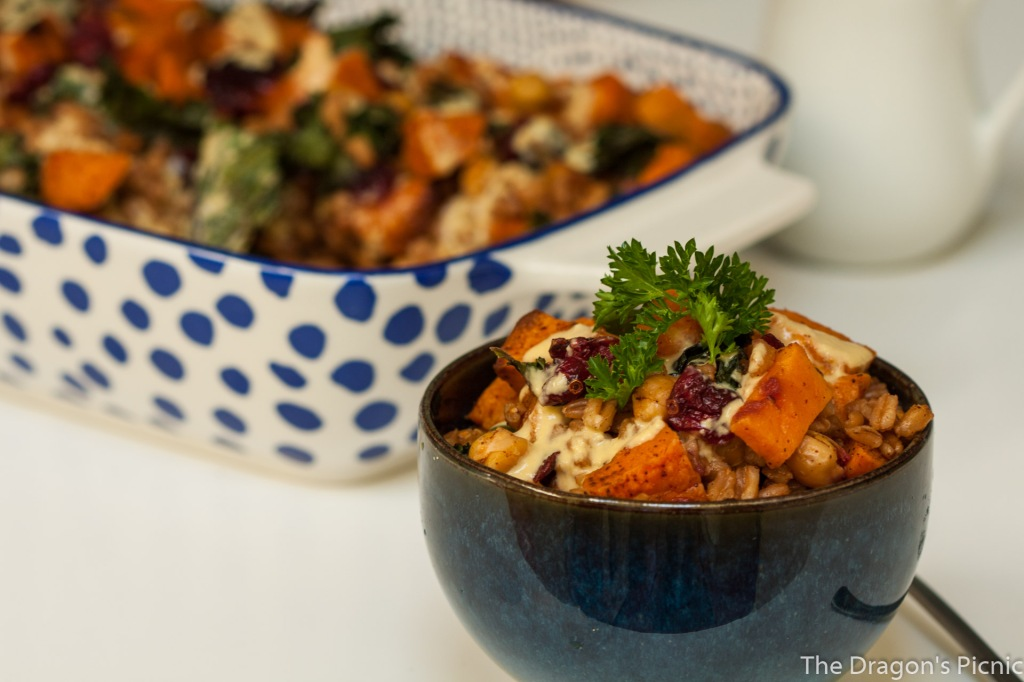 serving dish and bowl with farro, kale and roasted sweet potato salad and lemon tahini sauce