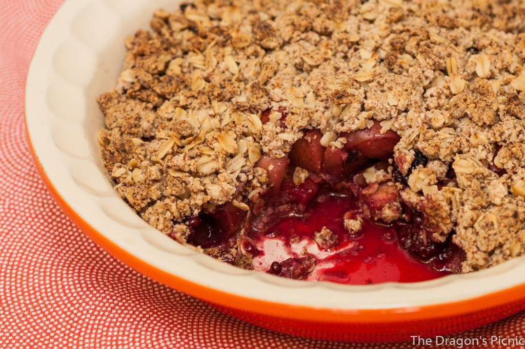Serving dish of apple and blackberry crumble (vegan and gluten free).