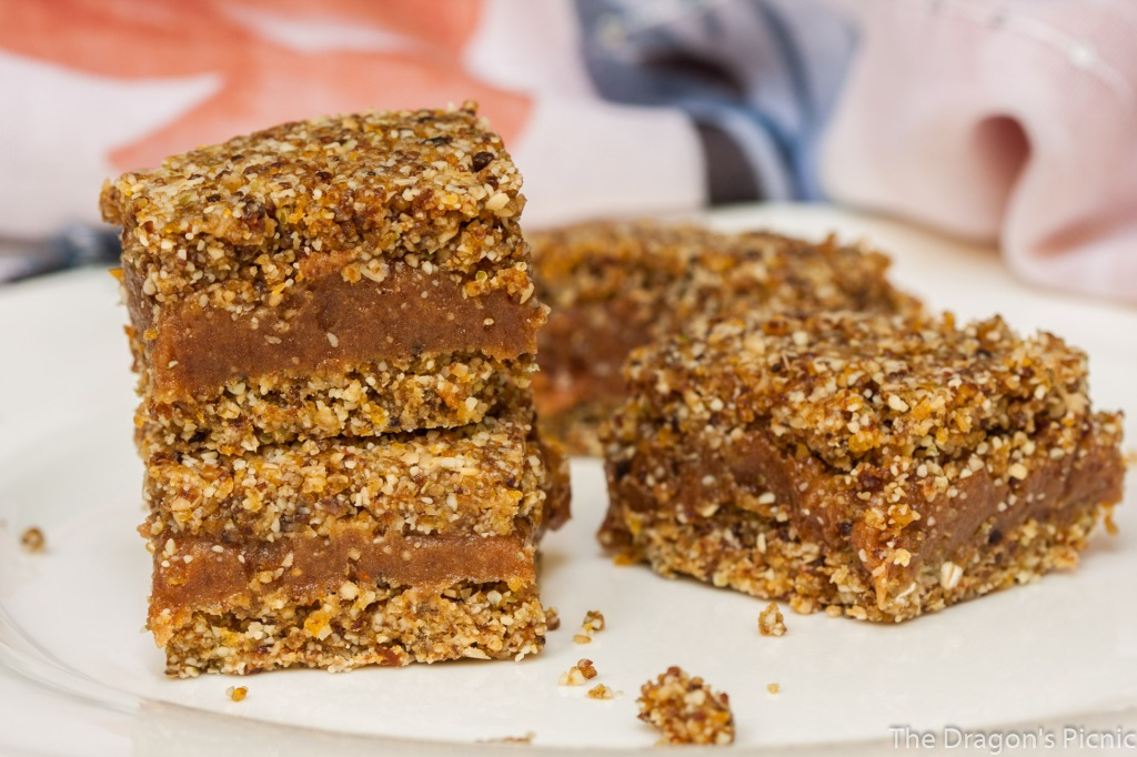 white plate with stack of apricot and peanut bars