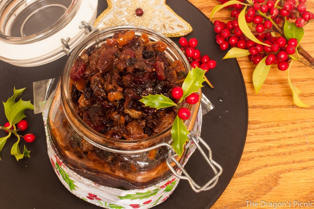 one jar of mincemeat with holly and Christmas decorations