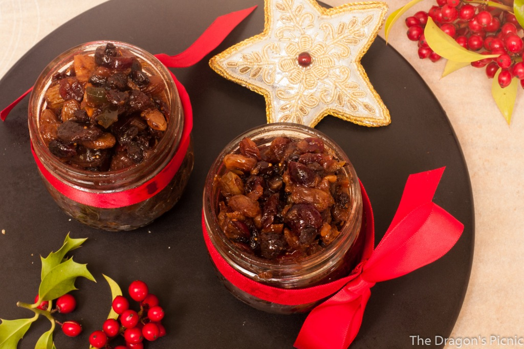 arial view of two jars of mincemeat with holly and Christmas decorations