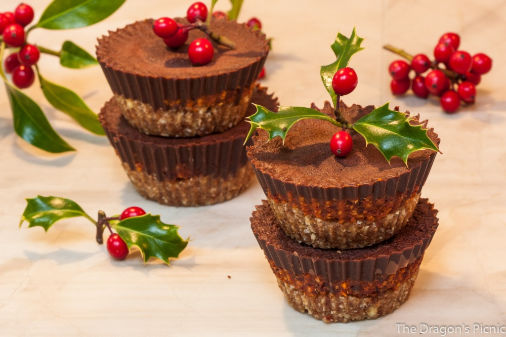 two stacks of two gingerbread and cranberry dark chocolate cups with holly decorations