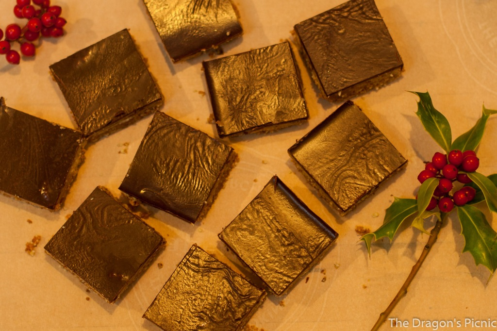 sky view of plate of tahini bars decorated with holly