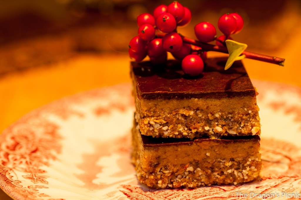 stack of 2 tahini bars on plate decorated with holly